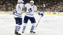 Dion Phaneuf #3 of the Toronto Maple Leafs celebrates with teammate Clarke MacArthur #16 of the Toronto Maple Leafs after MacArthur's second period power play goal against the Pittsburgh Penguins on October 13, 2010 at Consol Energy Center in Pittsburgh, Pennsylvania. (Jamie Sabau/2010 Getty Images)