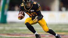 Hamilton Tiger-Cats' Chris Williams runs the ball against the Calgary Stampeders during first half CFL action at Ivor Wynne Stadium in Hamilton, Ontario, Thursday, Aug. 9, 2012. Williams is getting his NFL shot. Dan Vertlieb, Williams' Vancouver-based agent, told The Canadian Press on Thursday the former Hamilton Tiger-Cats star has signed with the NFL's New Orleans Saints. (GEOFF ROBINS/THE CANADIAN PRESS)