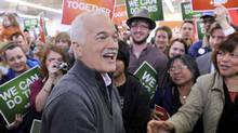 Canada's NDP leader Jack Layton greets supporters as he arrives at a campaign rally in Winnipeg on April 27, 2011. (FRED GREENSLADE/REUTERS)