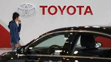A man walks past Toyota Motor's logo at the company's showroom in Tokyo in this file photo. (Toru Hanai/Reuters)