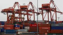 Cargo containers are stacked up as three cranes used to load and unload them from cargo ships tower above at the Port of Vancouver in Vancouver, B.C., on Thursday October 16, 2008. (DARRYL DYCK/THE CANADIAN PRESS)