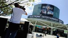A member of the media using a video camera records the front entrance of the Los Angeles Convention Center in preperation for the E3 Expo on June 5, 2011 in Los Angeles, California. The Electronic Entertainment Expo officially starts on Tuesday. (Kevork Djansezian/Getty Images)