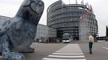 A giant inflatable baby seal is disposed in front of the European Parliament in Strasbourg in this May 5, 2009, file photo. The European Parliament adopted legislaton banning seal products in its member nations on Sept. 16, 2009. (Vincent Kessler/Reuters)