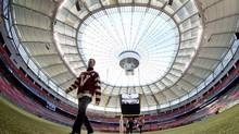 Vancouver Canucks' Daniel Sedin, of Sweden, walks off the field after a media availability to promote the 2014 NHL Heritage Classic in Vancouver, B.C., on Thursday December 5, 2013. The NHL hockey game between the Vancouver Canucks and Ottawa Senators is scheduled to be held on March 2, 2014 at B.C. Place stadium. (DARRYL DYCK/THE CANADIAN PRESS)