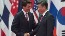 Canadian Prime Minister Justin Trudeau is greeted by Chinese President Xi Jinping in Hangzhou on Sept. 4, 2016. (Adrian Wyld/THE CANADIAN PRESS)