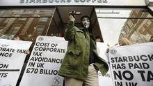 Starbucks has become a lightning rod in Britain for protesters demanding that foreign companies pay their fair share of taxes. (LUKE MACGREGOR/REUTERS)