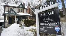 A realtor's 'Sold' sign stands outside a Toronto home in this file photo. (Fred Lum/Fred Lum/The Globe and Mail)