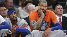 New York Knicks centre Tyson Chandler, right, and guard Toure' Murry watch during the second half of Knicks' NBA basketball game against the Oklahoma City Thunder at Madison Square Garden, Wednesday, Dec. 25, 2013, in New York. (JOHN MINCHILLO/AP)