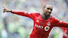 Toronto FC forward Jermain Defoe (18) celebrates his goal against the Seattle Sounders FC during the first half at CenturyLink Field. (Joe Nicholson/USA Today Sports)