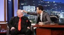 "This March 3, 2014 image released by ABC shows Toronto Mayor Rob Ford, left, having his forehead wiped by host Jimmy Kimmel on the late night talk show ""Jimmy Kimmel Live,"" in Los Angeles. (Randy Holmes/AP)"