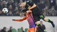 Möenchengladbach's Tony Jantschke, right, gets above Manchester City's David Silva to win a header during the two sides' group match in Champions League play on Wednesday. (Martin Meissner/AP)
