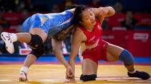 Canada's Carol Huynh (red) takes on Japan's Hitomi Obara (blue) in the women's freestyle 48 kg semi-final at the 2012 Summer Olympics in London, England, Wednesday August 8/2012. Huynh lost the match 3-1. (Kevin Van Paassen/The Globe and Mail)