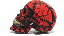 Intricate patterns are a hallmark of Mexican-born, Toronto-based designer Ricky Sosa's work, including this beaded resin skull from his Come Up To My Room project Revolucionario.