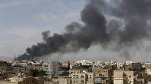 Smoke billows from a site hit by Saudi-led air strikes in Yemen's capital Sanaa January 30, 2016. (KHALED ABDULLAH/REUTERS)