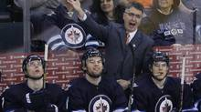 Winnipeg Jets' head coach Claude Noel disputes a call during third period NHL action against Montreal Canadiens in Winnipeg on Thursday, April 25, 2013. (JOHN WOODS/THE CANADIAN PRESS)