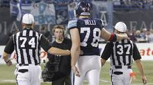 Adriano Belli with referees at the 100th Grey Cup game played in Toronto on Nov. 25, 2012 between the Toronto Argonauts and the Calgary Stampeders. (Peter Power/The Globe and Mail)