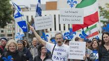 Supporters of a proposed Quebec values charter march in Montreal on Sept. 22, 2013. Th (Graham Hughes/The Canadian)
