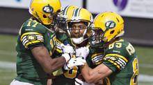 Edmonton Eskimos' Shamawd Chambers (17), quarterback Pat White (5) and Nate Coehoorn (85) celebrate a touchdown against theToronto Argonauts during first half action in Edmonton (JASON FRANSON/THE CANADIAN PRESS)