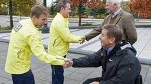 General-General David Johnston and Rick Hansen shake hands with relay participants at Rideau Hall on Oct. 26, 2011 to mark the 25th anniversary of the Man in Motion tour. (FRED CHARTRAND/THE CANADIAN PRESS)