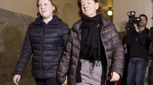 Alison Redford arrives at the Alberta Legislature with her daughter Sarah on Thursday, a day after her resignation. A former staffer says she decided to put her family first. (JASON FRANSON/THE CANADIAN PRESS)