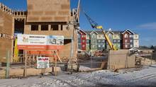 Construction crews build housing and community centres in Saskatoon, Sask., in this file photo. (Liam Richards/THE CANADIAN PRESS)