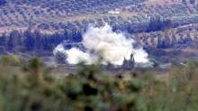 Smoke rises after a mortar bomb fired from Syria landed in Turkish soil on the Turkish-Syrian border in southern Hatay province (Reuters)