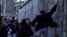 Fall of the Berlin Wall, November 1, 1989. The Brandenburg Gate is visible in the background. (NATO)