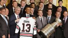 U.S. President Barack Obama poses during a ceremony honoring the 2013 National Hockey League Stanley Cup champions Chicago Blackhawks (LARRY DOWNING/Reuters)
