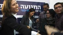 Tzipi Livni, greeting supporters in Tel Aviv Tuesday, is running for office as head of a new political party she vows will 'fight for peace.' (NIR ELIAS/REUTERS)