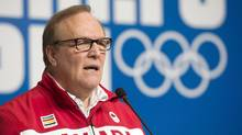 Marcel Aubut speaks during a news conference at the Sochi Winter Olympics on February 6, 2014 in Sochi, Russia. An independent probe of alleged impropriety by the former Canadian Olympic Committee president said a majority of the more than 100 staff members interviewed for the review experienced or saw sexual and personal harassment. (Adrian Wyld/THE CANADIAN PRESS)