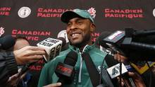 Saskatchewan Roughriders' head coach Corey Chamblin smiles during a news conference in Regina, Saskatchewan, November 19, 2013. The Saskatchewan Roughriders will play the Hamilton Tiger Cats in the CFL's 101st Grey Cup in Regina on November 24, 2013. (TODD KOROL/REUTERS)