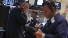 Traders work on the floor of the New York Stock Exchange August 21, 2013. (BRENDAN MCDERMID/REUTERS)