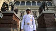 """A guard watches over the Grand Palace in Bangkok, Thailand on Friday, March 23, 2012. """"We hope tourists can see with their own eyes what Thailand is like. Street View will help their decision-making process in a positive way in regards to visiting Thailand,"""" says Pongrit Abhijatapong, marketing information technology officer at the Tourism Authority of Thailand. Google has not always been able to count on such enthusiasm elsewhere in Asia, illustrating the challenges the company has faced besides high-profile spats with China over privacy and India over removing offensive content. (Sean Kilpatrick/Sean Kilpatrick/THE CANADIAN PRESS)"""
