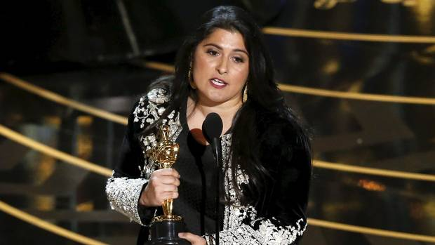 "Pakistani journalist and filmmaker Sharmeen Obaid-Chinoy accepts the award for Best Documentary Short Subject Film for ""A Girl in the River: The Price of Forgiveness"" at the 88th Academy Awards. (MARIO ANZUONI/REUTERS)"
