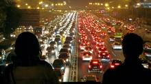Beijing's congestion, which causes commutes of up to five hours and traffic jams that can last days, exemplifies the problem of too many cars in dense urban settings. (ChinaFotoPress/Getty Images)