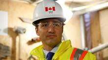 Canada's Prime Minister Justin Trudeau takes part in an event marking the completion of masonry work on West Block on Parliament Hill on Feb. 1, 2017. (CHRIS WATTIE/REUTERS)