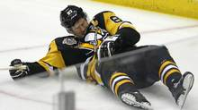 The Pittsburgh Penguins' Sidney Crosby after taking a hit from Washington Capitals' Matt Niskanen during the first period of Game 3 in an NHL Stanley Cup Eastern Conference semifinal game on Monday, May 1, 2017. (Gene J. Puskar/The Associated Press)