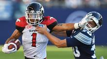 Stampeders wide receiver Lemar Durant pushes off tLirim Hajrullahu during first half CFL action in Toronto on Monday, Oct. 10, 2016. (Frank Gunn/THE CANADIAN PRESS)