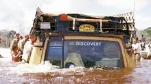 A Land Rover Discovery drives through water (Land Rover)