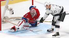 Montreal Canadiens goalie Carey Price makes a save on Los Angeles Kings right wing Dustin Brown during the second period at Bell Centre. (USA TODAY Sports)