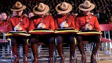 Holding Stetsons of slain RCMP officers are from left, Joan Kuyp; Joe Sangster; Bethany Hoskin and Jason Lapointe. A memorial for the officers killed near Mayerthorpe, Alta.in 2005. (Fred Lum/THE GLOBE AND MAIL)