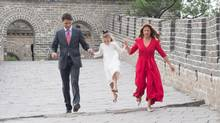 Prime Minister Justin Trudeau and Sophie Gregoire hold Ella-Grace's hand as she jumps over a drainage pipe as they visit a section of the Great Wall of China, in Beijing on Thursday, September 1, 2016. (Adrian Wyld/THE CANADIAN PRESS)