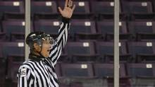 A referee makes a call during semi-final hockey play between the Sticks and Stones vs. the Hellfire in the True North League at the Powerade centre in Brampton, September 1, 2011. (J.P. MOCZULSKI For The Globe and Mail)