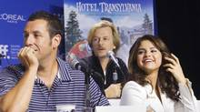 "(L-R) Adam Sandler, David Spade and Selena Gomez attend a news conference to promote their film ""Hotel Transylvania"" at the 37th Toronto International Film Festival, September 8, 2012. (Reuters)"
