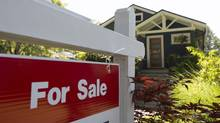 A sold sign is pictured outside a home in Vancouver. (JONATHAN HAYWARD/THE CANADIAN PRESS)