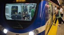 Skytrain passengers on the Canada Line make their way on to the train in Vancouver, August 8, 2013. (John Lehmann/The Globe and Mail)