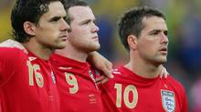 England's Owen Hargreaves, Wayne Rooney and Michael Owen (L-R) listen to their national anthem before the start of their Group B World Cup 2006 soccer match against Sweden in Cologne June 20, 2006. (EDDIE KEOGH/REUTERS)