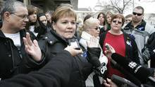 Carol DeDelley, mother of Tim McLean, and family members talk to media outside the Law Courts in Winnipeg on Thursday, March 5, 2009, after the verdict from the trial of Vince Li, the man who stabbed and beheaded McLean on a Greyhound Bus. Mr. Li was found to be not criminally responsible by reason of a mental disorder. (John Woods/The Canadian Press)