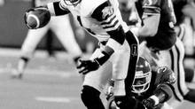 The Saskatchewan Roughriders in game action against the Hamilton Tiger-Cats at SkyDome in Toronto on November 26, 1989. At left is Tiger-Cat player Earl Winfield (1). Saskatchewan defeated the Tiger-Cats, 43-40, to win the 77th Grey Cup. (Thomas Szlukovenyi/The Globe and Mail)