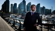 Andy Yan poses for a photograph in Coal Harbour in Vancouver, B.C., on Wednesday April 10, 2013. (DARRYL DYCK For The Globe and Mail)